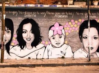 Imagen de un grafitti sobre feminicidio con varias caras femeninas